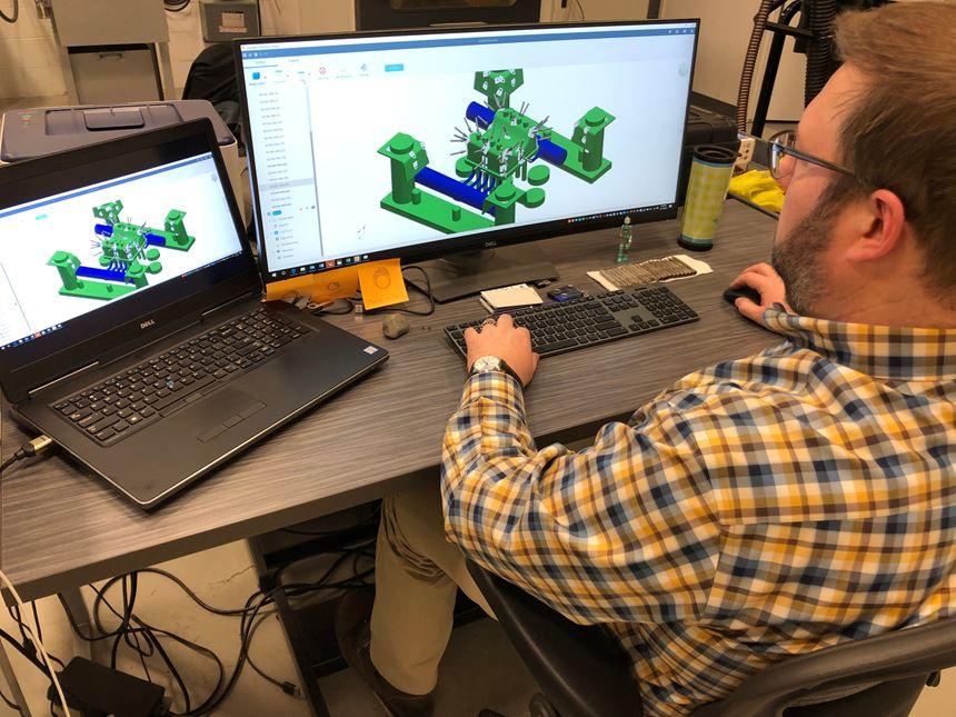 man at computer designing a mold