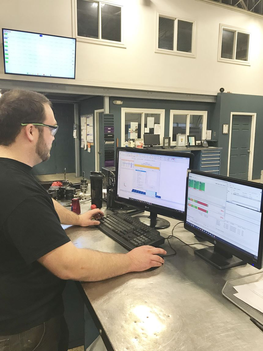 A TK Mold employee uses RER Software to monitor machine activity