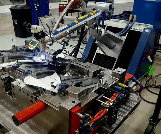 Alpha Laser - US ALFlak 300 laser welder applying weld to complex mold.