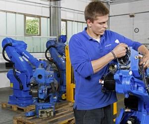man fixing robot