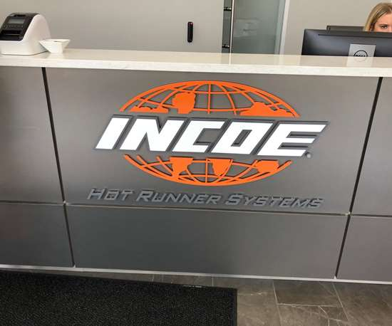Incoe Corp. logo on counter in entry to new global headquarters