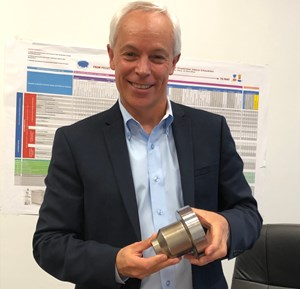 DME President Peter R. Smith holding new Cooled Gate Bushing