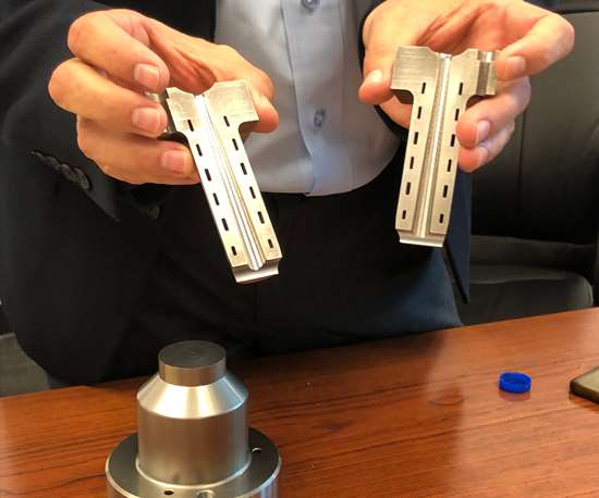 DME President Peter R. Smith holding new Conformal Cooled Cold Sprue Bushing