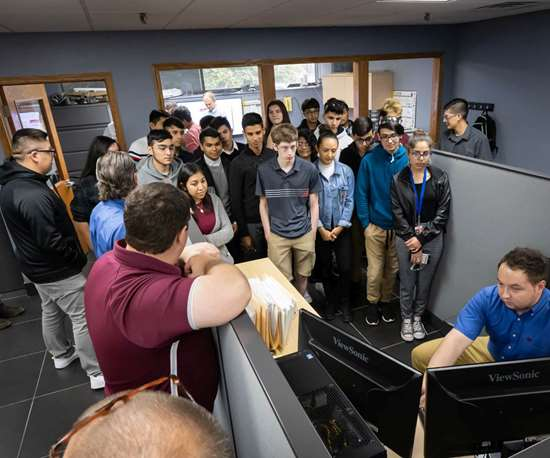 Students watching mold design at A-1 Tool Corp. on MFG Day 2019