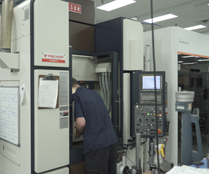 An X-Cell Tool and Mold team member sets up a Yasda for lights-out machining.