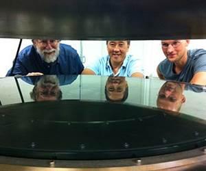 men looking at vacuum coating