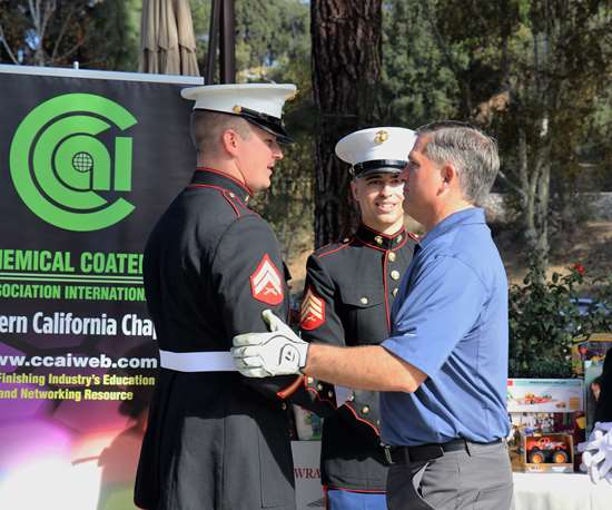 man shaking hands with marine