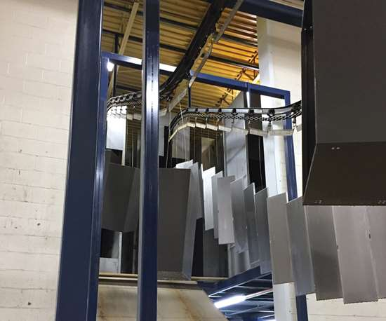 Affordable Interior System's parts run through an elevated conveyor line to save space.
