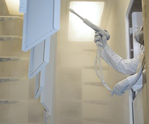 Powder coater uses Rohner hand powder booth at Affordable Interior Systems