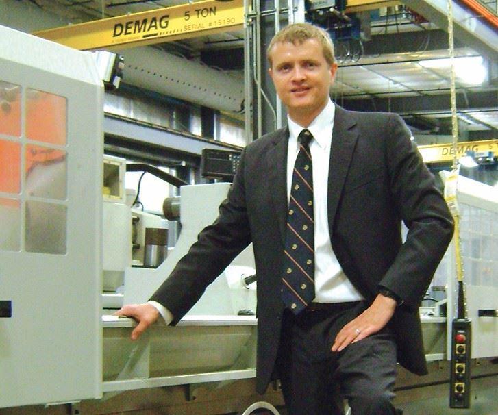 man standing near machine