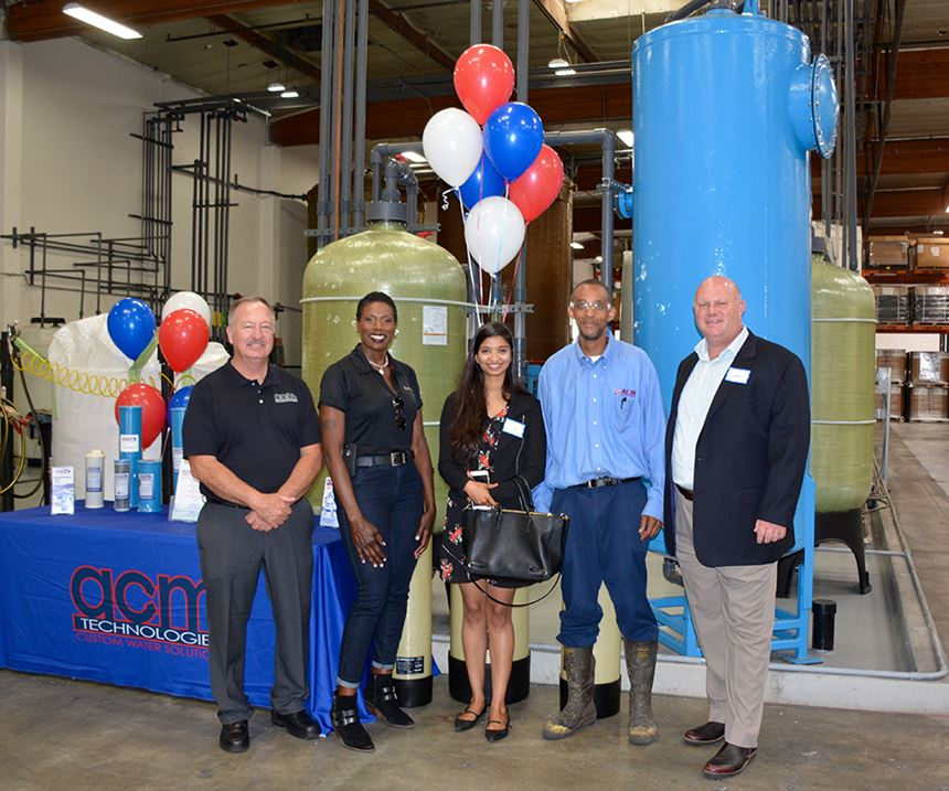 Attendees at ACM Technologies' open house, touring its ion exchange resin regeneration plant and laboratory.