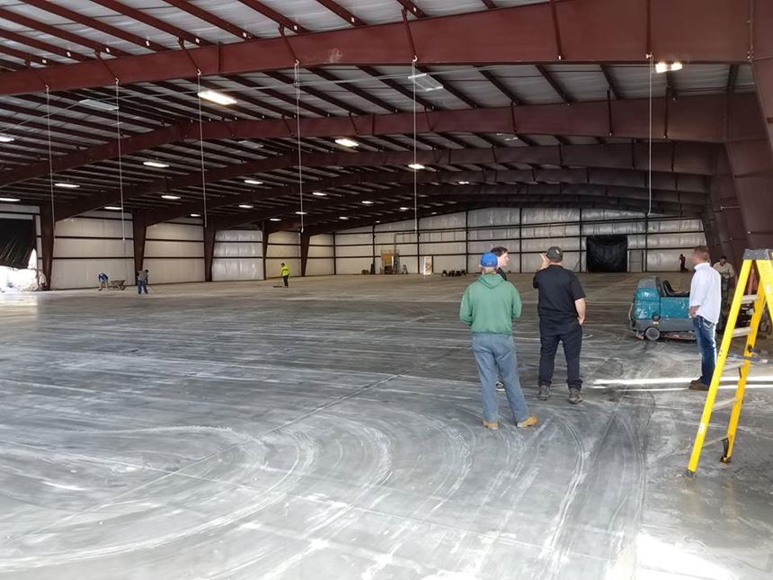 men looking at an empty facility