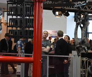 people looking at painting equipment