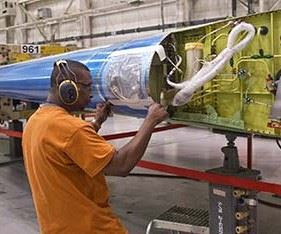 man working on airplane wing