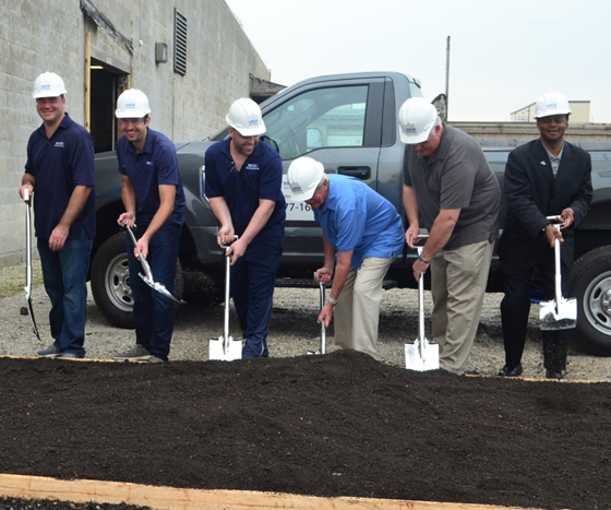 people breaking ground on new plant