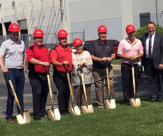people with shovels at groundbreaking
