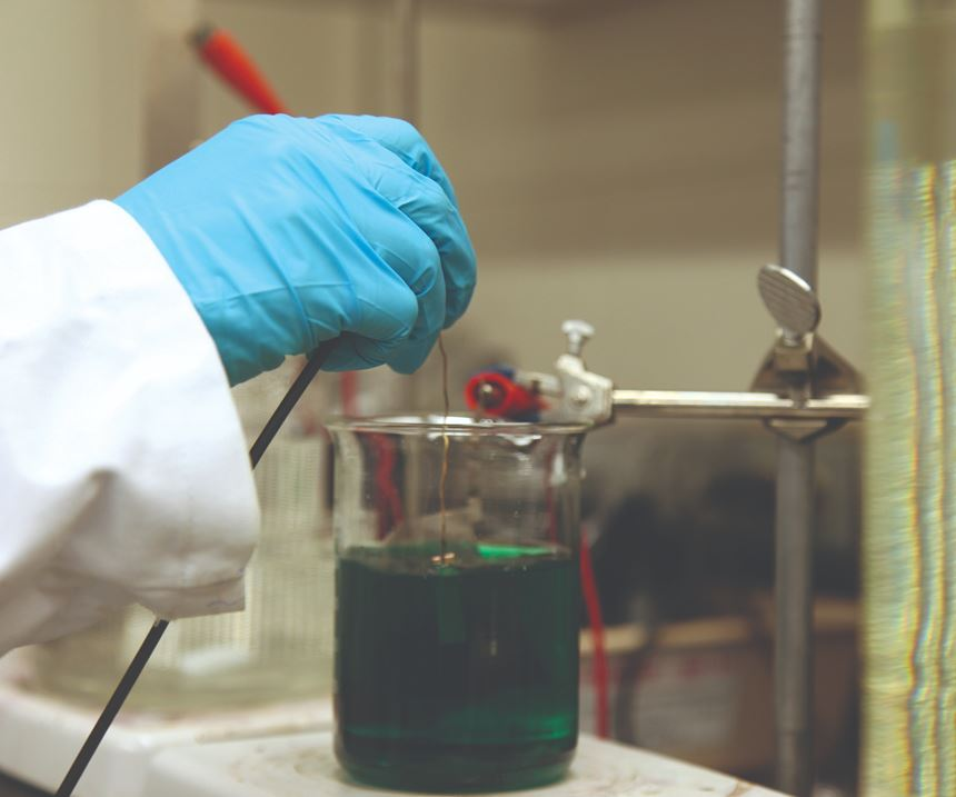 person mixing chemicals