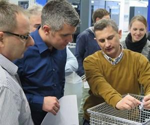 men looking at parts