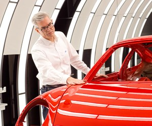 man inspecting paint car