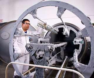 man at plating machine