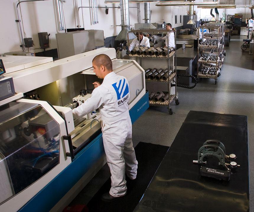 man at finishing machine