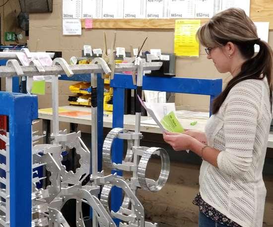 woman looking at parts