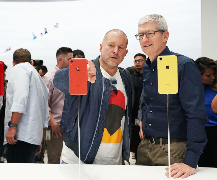 two men looking at iPhones