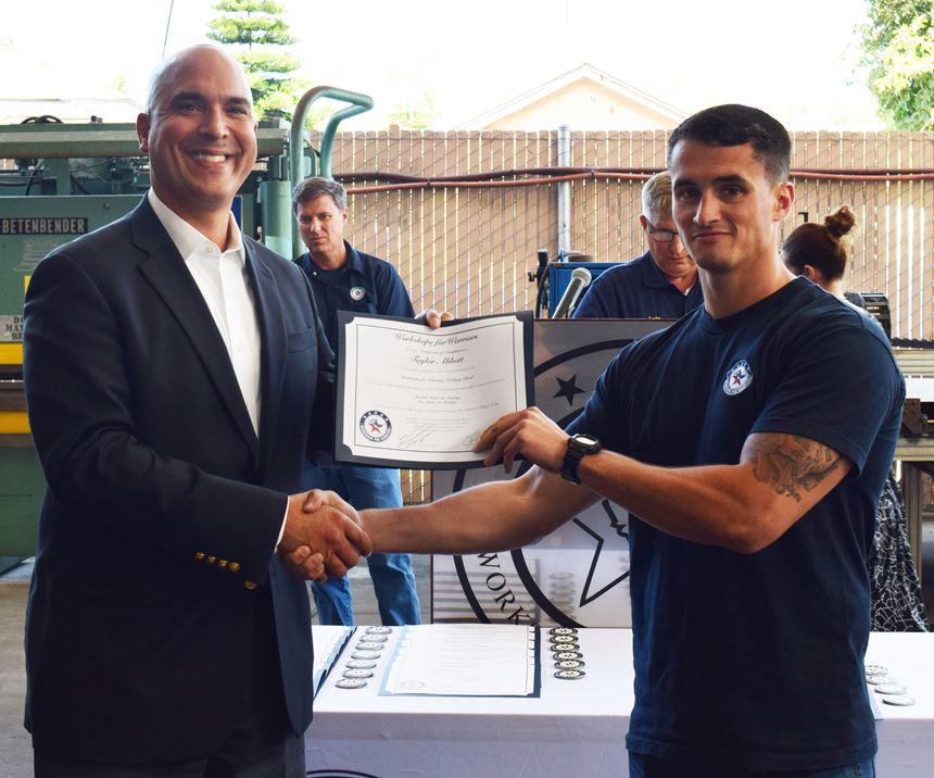 man getting diploma