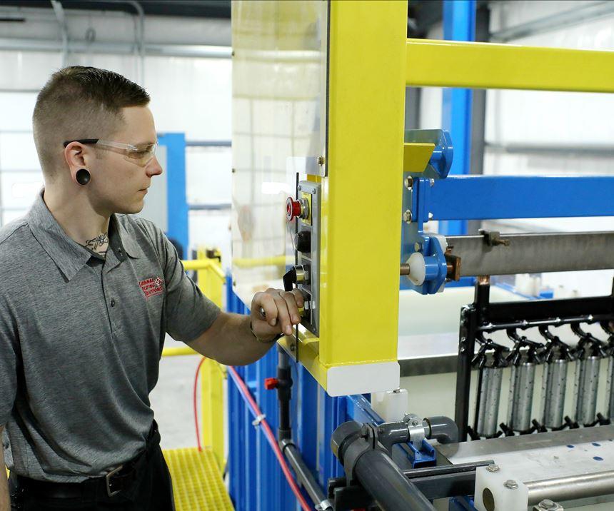 man working on plating line