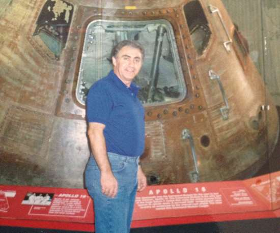 man in front of Apollo 16 module
