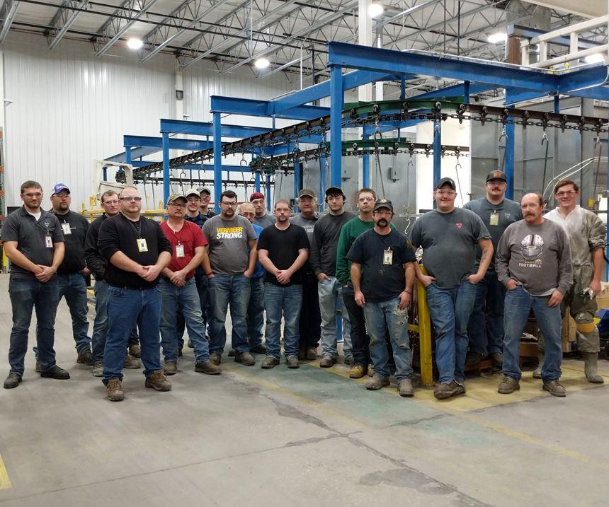 men standing in front of liquid line