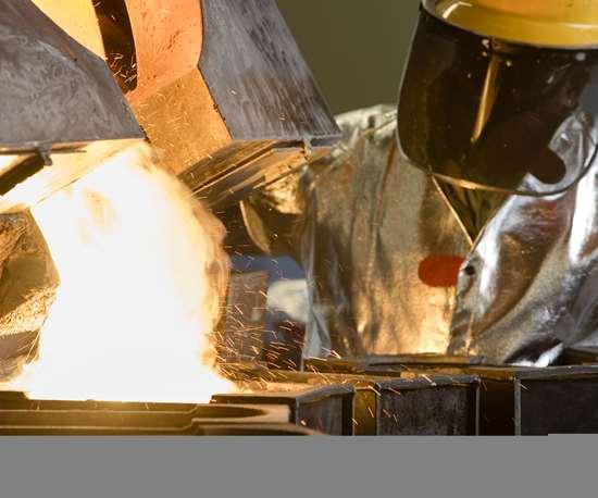 man melting metals