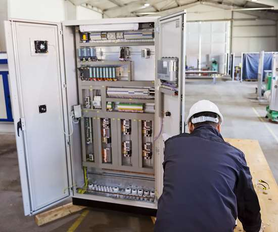man at a control panel