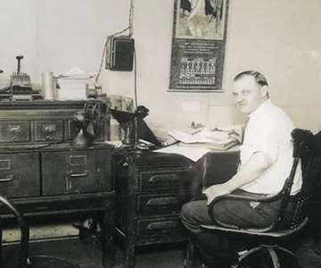 man sitting at a desk