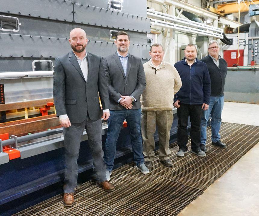 men standing on a plating shop floor