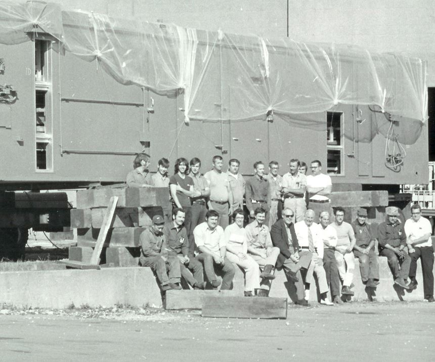 men standing in front of system
