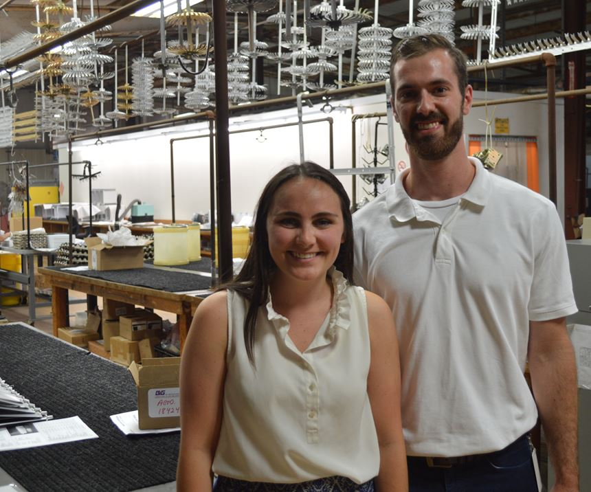 man and woman standing in a plating shop
