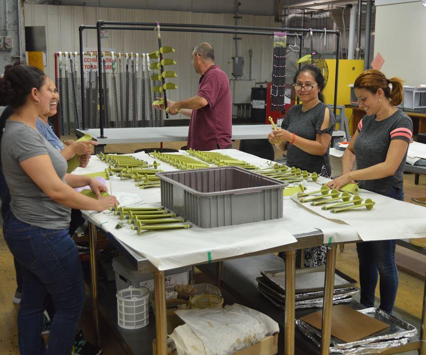 women working on parts