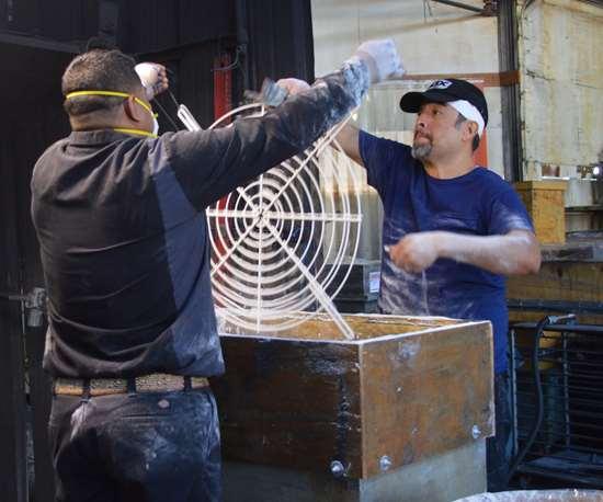 men coating parts