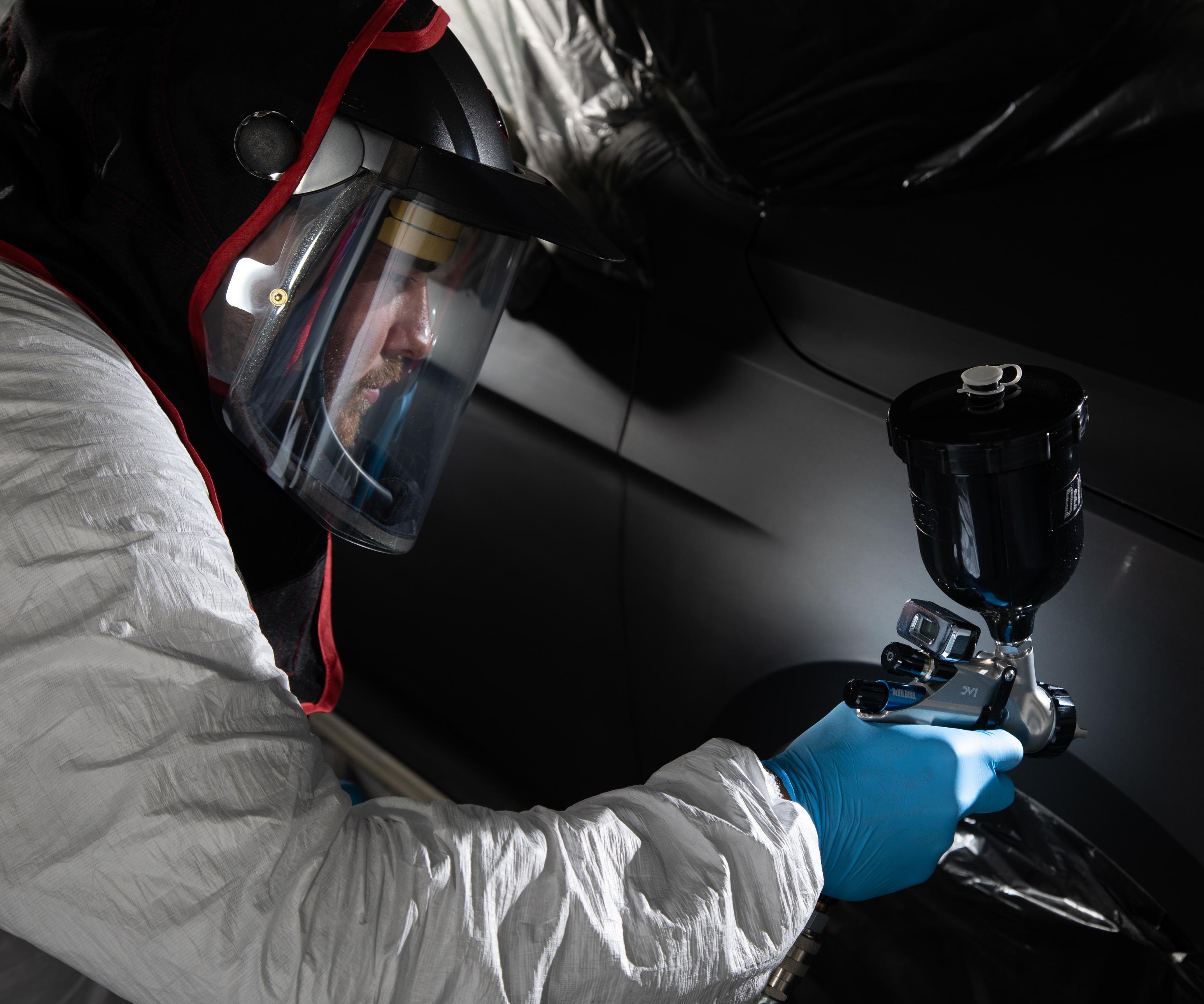 man spraying coating