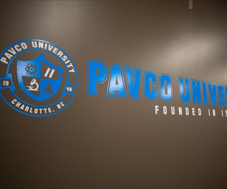 wall with lettering that says Pavco University