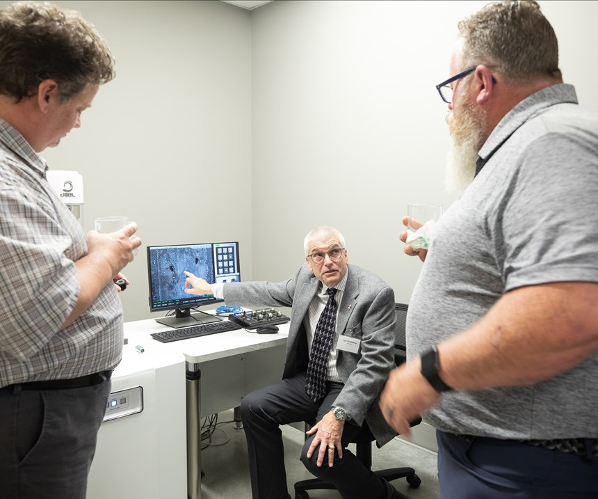 man using a computer to explain finishing