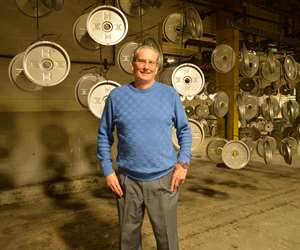 Paul Springer standing in his shop