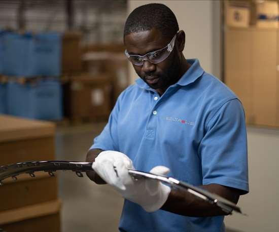 man looking at parts