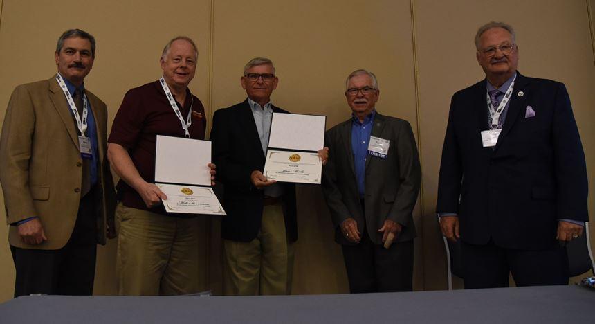 men holding awards
