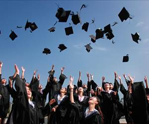 students throwing hat into air
