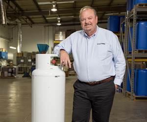 man standing next to an air tank