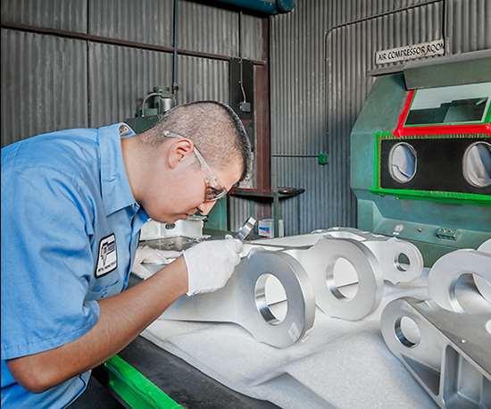 man inspecting parts