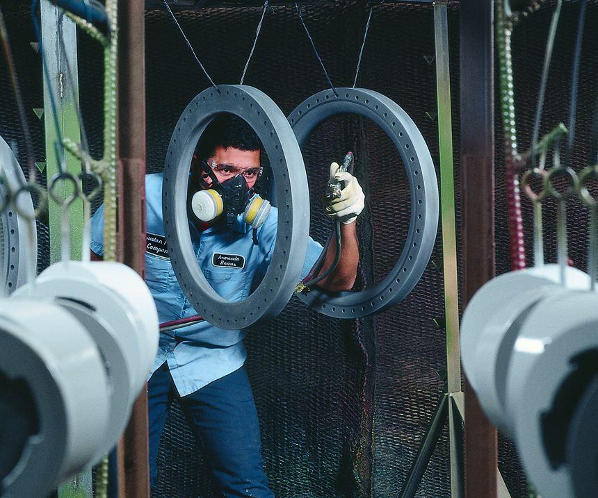 man spraying parts