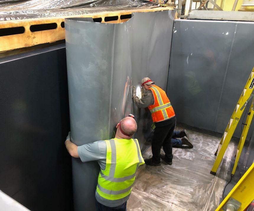 men installing a liner